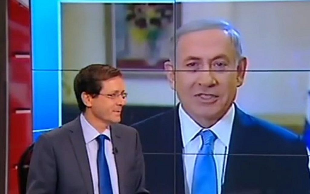 Prime Minister Benjamin Netanyahu speaks to Channel 2 as Zionist Union head Isaac Herzog sits in the studio, March 14, 2015 (Channel 2 News)