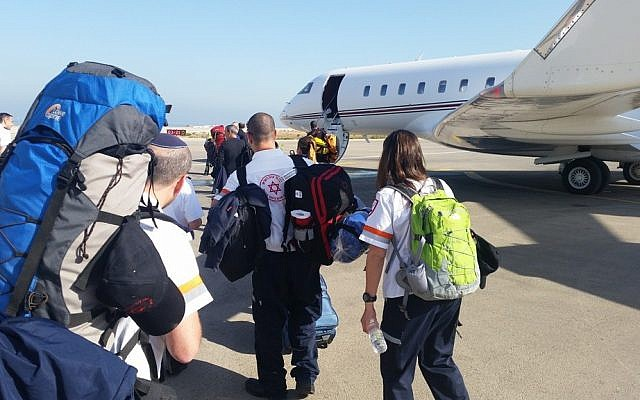 Medical workers with Magen David Adom board a plane to Kathmandu on Sunday morning at the Sde Dov Airport in Tel Aviv (photo courtesy Magen David Adom)