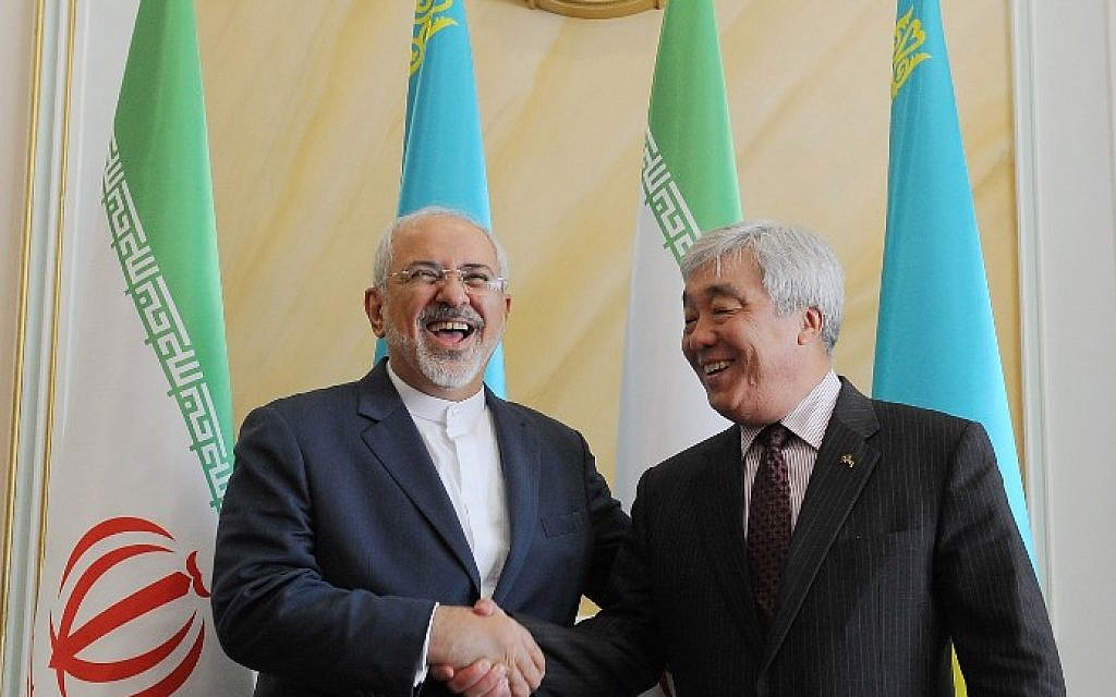 Kazakh Foreign Minister Yerlan Idrisov, right, shakes hands with his Iranian counterpart Mohammad Javad Zarif during their meeting in Astana on April 13, 2015. (photo credit: AFP/ILYAS OMAROV)