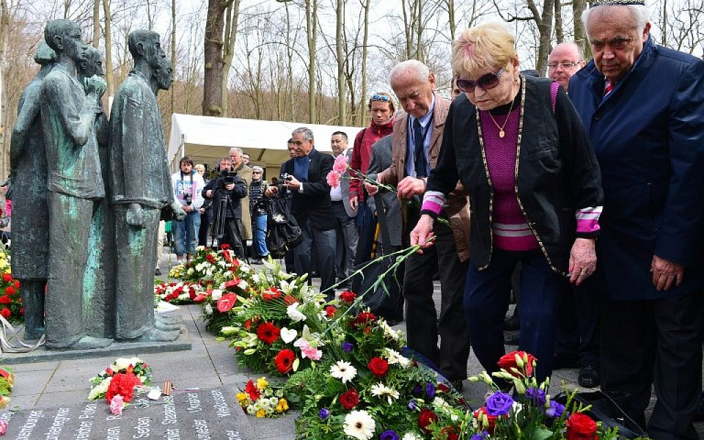 Participants attend a wreath ceremony during a commemorative event on the 70th anniversary of the liberation of concentration camp Mittelbau-Dora in Nordhausen, eastern Germany, on April 13, 2015. (photo credit: AFP/DPA/MARTIN SCHUTT)