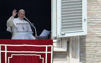 Pope Francis addresses the crowd from the window of the apostolic palace overlooking St.Peter's square during the Regina Coeli prayer on April 19, 2015 at the Vatican. (photo credit: AFP PHOTO / TIZIANA FABI)