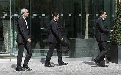 Iran's ambassador to the IAEA (International Atomic Energy Agency), Reza Najafi (C) leaves Coburg Palace during the E3/EU+3 and Iran talks in Vienna on April 22, 2015. (photo credit: AFP PHOTO / JOE KLAMAR)