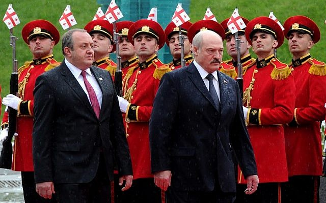 Belarus President Alexander Lukashenko, right, and his Georgian counterpart Giorgi Margvelashvili review an honor guard during a welcoming ceremony in Tbilisi on April 23, 2015. (photo credit: AFP/VANO SHLAMOV)