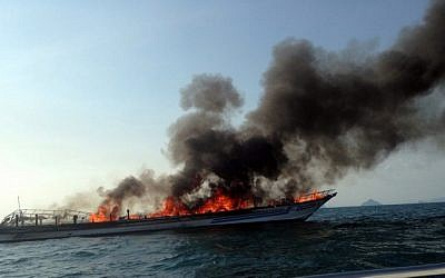 A general view shows the burning Phuket ferry near Noppharat Thara beach in Krabi province on April 8, 2015. (photo credit: AFP PHOTO)
