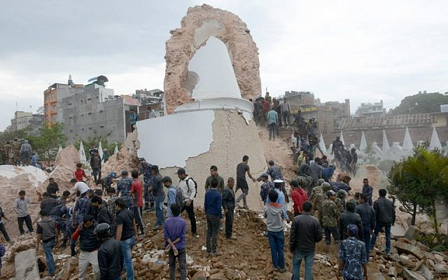 Nepalese rescue members and onlookers gather at the collapsed Dharahara Tower in Kathmandu on April 25, 2015. (photo credit: AFP/PRAKASH MATHEMA)