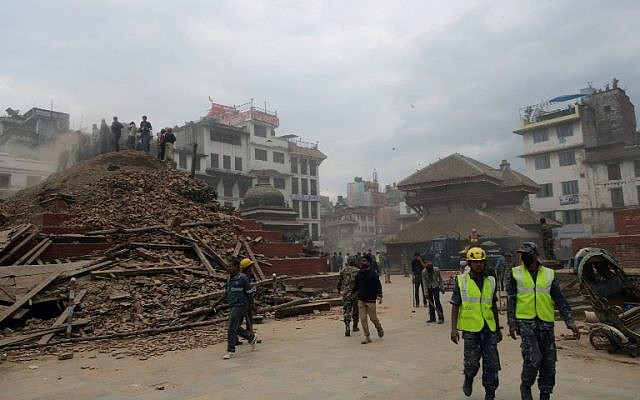 Nepalese rescue workers and onlookers gather at Kathmandu's Durbar Square, a UNESCO World Heritage Site that was severely damaged by an earthquake on April 25, 2015. (photo credit: AFP/PRAKASH MATHEMA)