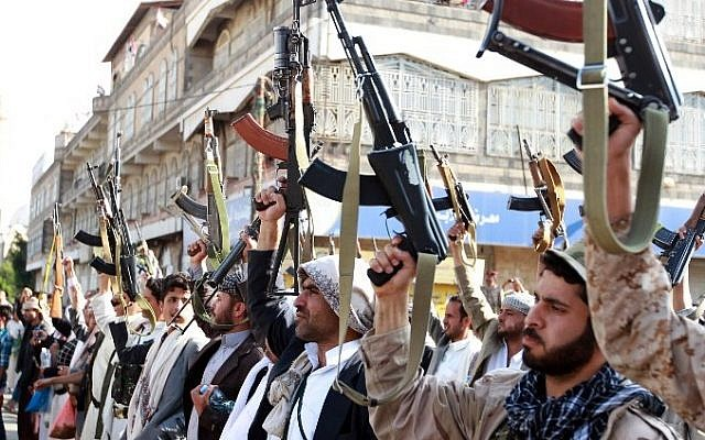 Tribal gunmen loyal to the Houthi movement brandish their weapons in the capital Sanaa on April 1, 2015, during a demonstration against Saudi-led coalition to drive out Houthi rebels from Yemen. (photo credit: AFP / MOHAMMED HUWAIS)