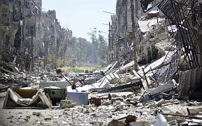 A general view showing the destruction in the Yarmouk Palestinian refugee camp in the Syrian capital of Damascus, April 6, 2015. (photo credit: AFP/STR)