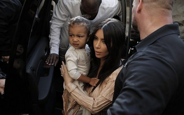 US reality TV star Kim Kardashian, her daughter North West and husband, rapper Kanye West, spent quality time in Jerusalem this week (photo credit: AFP/Ahmad Gharabli)