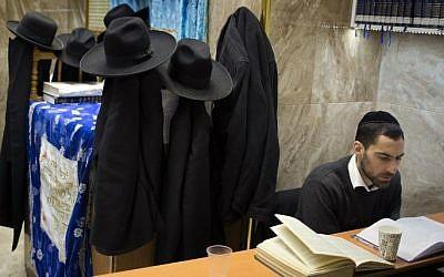 An ultra-Orthodox Jewish student studies the Torah at a synagogue in the Mea Shearim neighborhood of Jerusalem, April 15, 2015. (AFP/MENAHEM KAHANA)