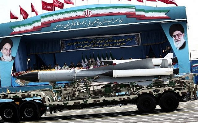 A S-200 surface-to-air missile system is driven past Iranian military commanders during the Army Day parade in Tehran on April 18, 2015. (Photo credit: Behrouz Mehri/AFP)