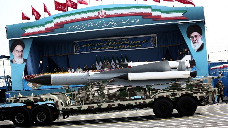 A S-200 surface-to-air missile system is driven past Iranian military commanders during the Army Day parade in Tehran on April 18, 2015. (Behrouz Mehri/AFP)