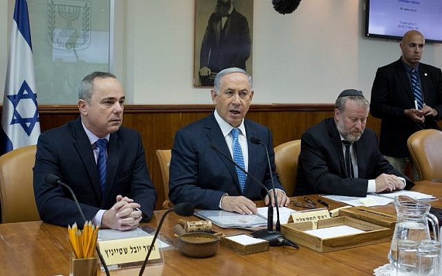 Prime Minister Benjamin Netanyahu (C) talks to the press during the weekly cabinet meeting in his Jerusalem office, on April 19, 2015 (photo credit: AFP/POOL/MENAHEM KAHANA)