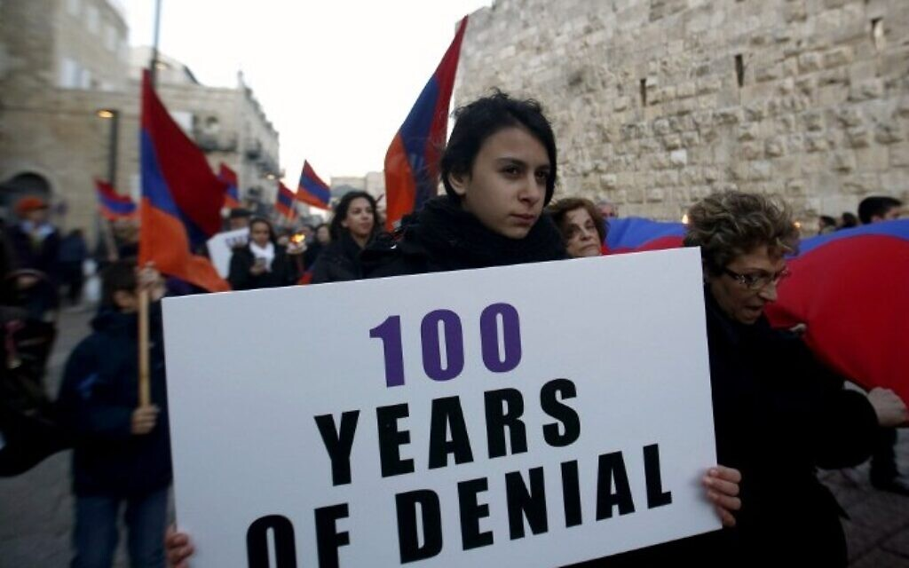 Members of the Armenian community march with flags and torches on April 23, 2015, in Jerusalem's Old City, on the eve of the 100th anniversary of the mass killings of Armenians under the Ottoman Empire in 1915. (AFP/Gali Tibbon)