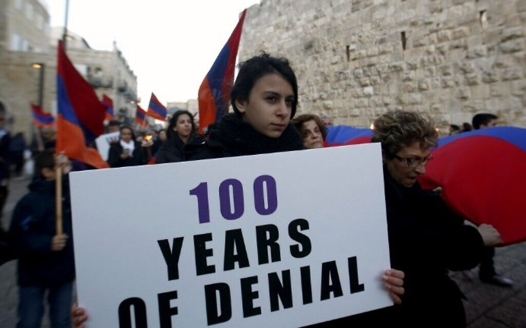 Members of the Armenian community march with flags and torches on April 23, 2015, in Jerusalem's Old City, on the eve of the 100th anniversary of the mass killings of Armenians under the Ottoman Empire in 1915. (photo credit: AFP/Gali Tibbon)