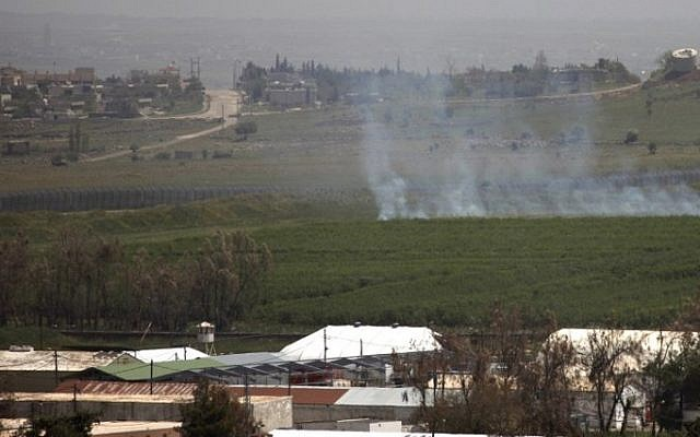 Illustrative: Smoke rises in a field on the Golan Heights, after two mortars fired from war-torn Syria struck the northern sector of the mountain plateau, April 28, 2015. (AFP/JALAA MAREY/File)