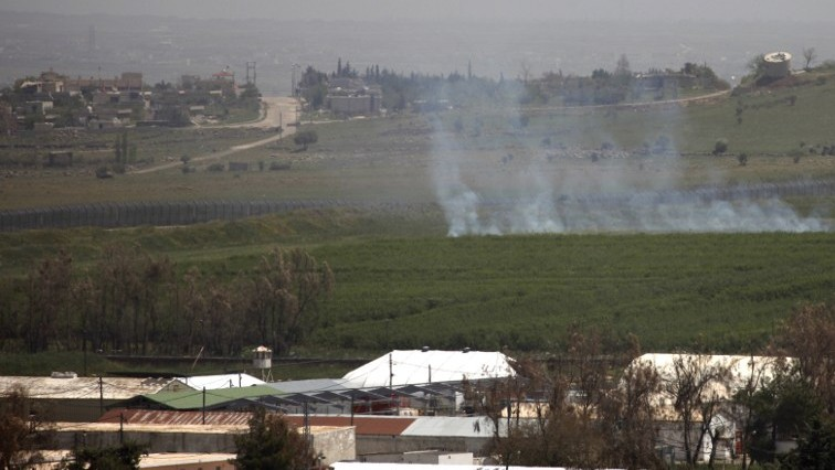 Illustrative Smoke rises in a field on the Golan Heights after two mortars fired from war-torn Syria struck the northern sector of the mountain plateau
