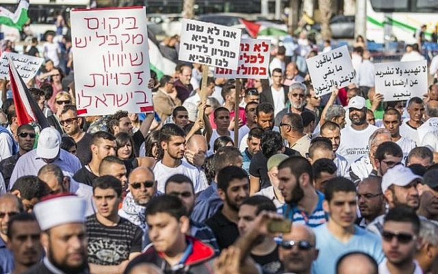 Arab Israelis take part in a rally organized by the High Follow-Up Committee for Arab Citizens of Israel, in protest against the demolition of homes in Arab communities, at Rabin Square, Tel Aviv, April 28, 2015. (AFP/JACK GUEZ)