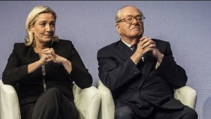 France's former far-right National Front party leader Jean-Marie Le Pen (R) and his daughter and current party leader Marine Le Pen (L) on November 29, 2014 (Jeff Pachoud/AFP)