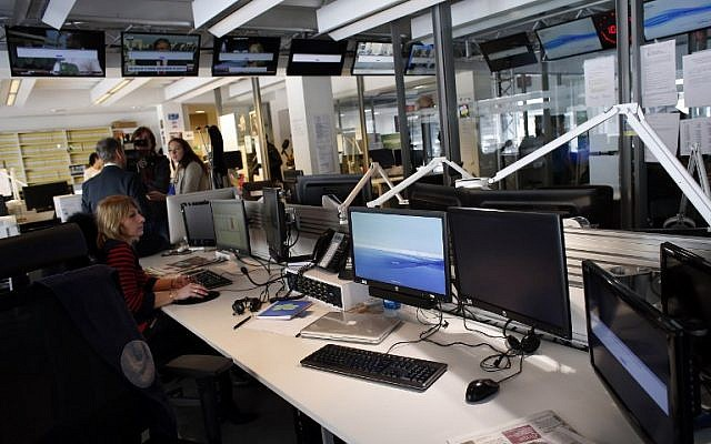 A picture taken on April 9, 2015 shows an empty newsroom at French television network TV5Monde headquarters in Paris, after TV5Monde was hacked by individuals claiming to belong to the Islamic State group.  (photo credit: AFP/Thomas Samson)