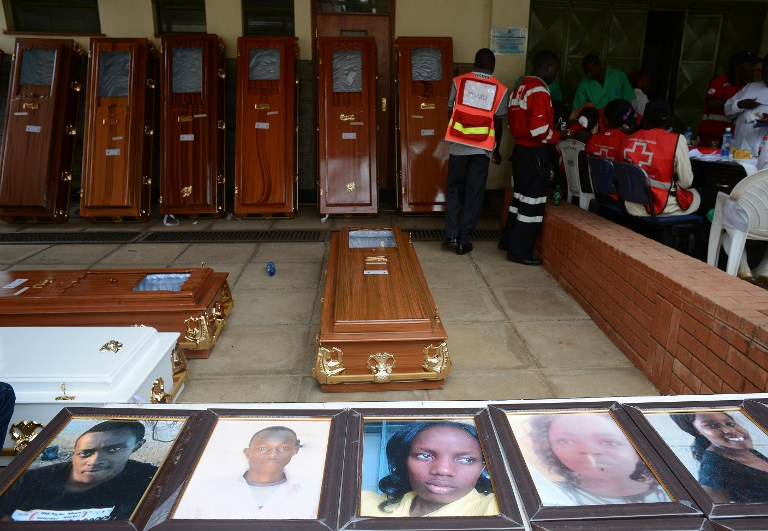 Portraits of the slain Garissa University students are displayed outside the Chiromo morgue, on April 9, 2015 in Nairobi. (photo credit: AFP/SIMON MAINA)