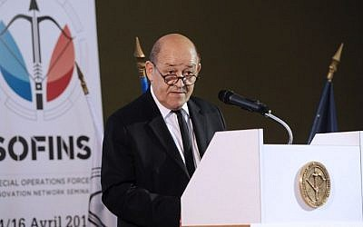French Defense Minister Jean-Yves Le Drian delivers a speech during his visit at the Special Operations Forces Innovation Network Seminar (SOFINS), on April 14, 2015 at Souge military camp in Martignas-sur-Jalle. (Mehdi Fedouach/AFP)