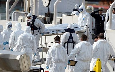 Italian Naval officers carry the body of a person who died after a fishing boat carrying migrants capsized off the Libyan coast, at Boiler Wharf, Senglea in Malta on April 20, 2015. (Matthew Mirabelli/AFP)