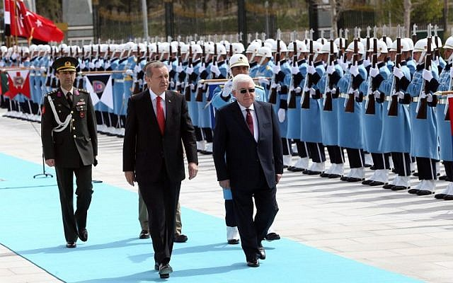 Turkish President Recep Tayyip Erdogan, left, and Iraqi President Fuad Masum, right, review the honor guard during an official welcoming ceremony prior to their meeting at the Presidential Palace in Ankara, on April 22, 2015. (photo credit: AFP/ADEM ALTAN)