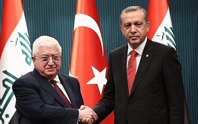 Turkish President Recep Tayyip Erdogan shakes hand with President of Iraq Fouad Massoum before a press conference in Ankara, on April 22, 2015. (Photo credit: AFP/ STR)