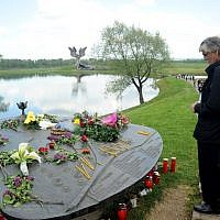 A man looks at the World War II Jasenovac memorial camp model on April 26, 2015, during a ceremony to remember the tens of thousands who were killed by Croatia's pro-Nazi regime. (AFP/Stringer)