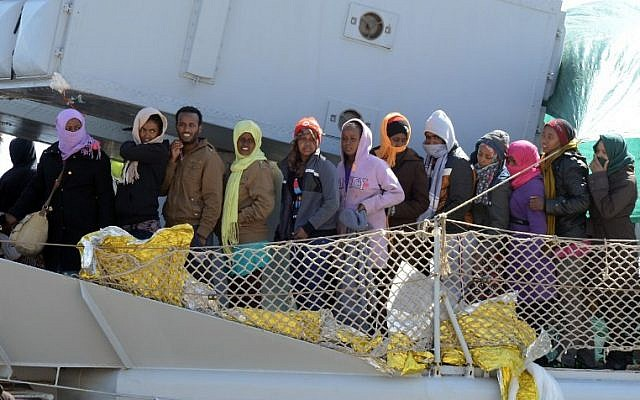 Illustrative photo of a boat transporting migrants arriving at the port of Messina after a rescue operation at sea on April 18, 2015 in Sicily. (Giovanni Isolino/AFP)
