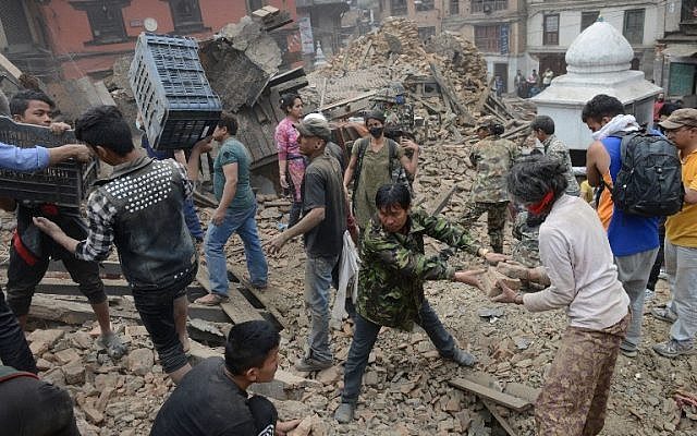 People clear rubble in Kathmandu's Durbar Square, a UNESCO World Heritage Site that was severely damaged by an earthquake on April 25, 2015. (photo credit: AFP/PRAKASH MATHEMA)