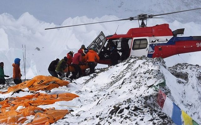 An injured person is loaded onto a rescue helicopter at Everest Base Camp,  April 26, 2015. (AFP/Roberto Schmidt)