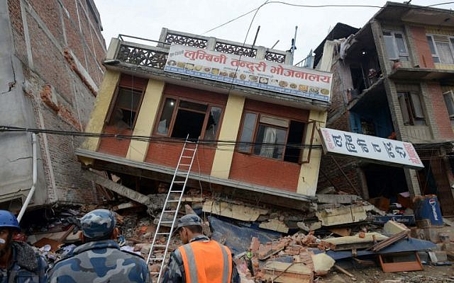 Nepalese rescue personnel observe damaged buildings following an earthquake in Kathmandu on April 26, 2015. (photo credit: AFP/PRAKASH MATHEMA)