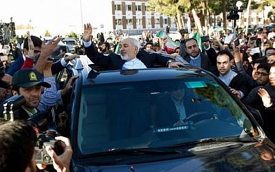 Iranian Foreign Minister Mohammad Javad Zarif greets people as the nuclear negotiating committee arrives at Mehr Abad Airport in Tehran on April 3, 2015, hours after announcing the ingredients of a nuclear deal with world powers. (photo credot: AFP/ISNA/Borna Ghasemi)