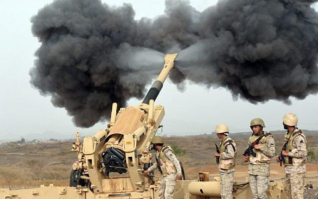 Saudi army artillery fire shells towards Yemen from a post close to the Saudi-Yemeni border, in southwestern Saudi Arabia, on April 13, 2015. (photo credit: AFP / FAYEZ NURELDINE)