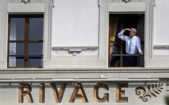 Illustrative: US Secretary of State John Kerry looks out of the window of his room at the Beau-Rivage Palace hotel during a break in Iran nuclear talks in Lausanne, Switzerland, on April 1, 2015. (AFP PHOTO/FABRICE COFFRINI)