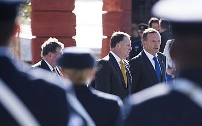 The Australian Prime Minister Tony Abbott (R) and Prime Minister of New Zealand John Key depart following the dedication of the Australia ANZAC memorial at Pukeahu National War Memorial Park in Wellington, New Zealand on APRIL 20, 2015. (photo credit: AFP/MARTY MELVILLE)