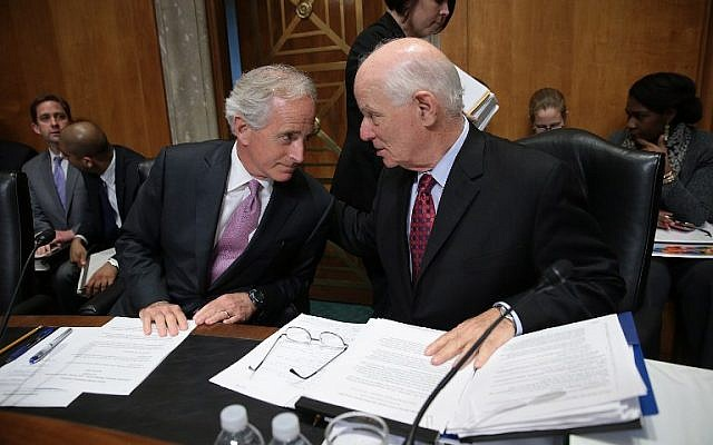 Senate Foreign Relations Committee Chairman Sen. Bob Corker (left) confers with ranking member Sen. Ben Cardin (right) during a committee markup meeting on the proposed nuclear agreement with Iran,  in Washington, DC, April 14, 2015. (Win McNamee/Getty Images/AFP)