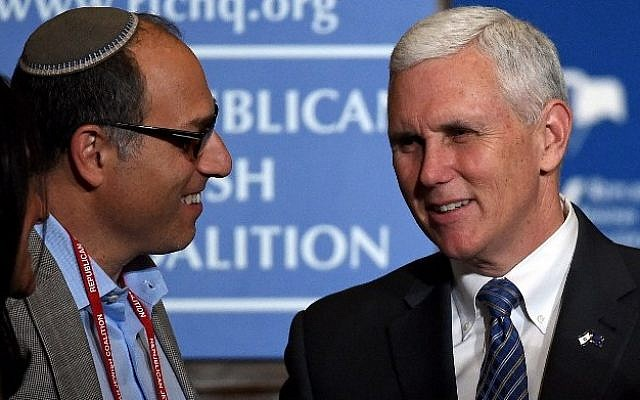 Attendee Bernard Hasten, left, talks with Indiana Gov. Mike Pence after he spoke during the Republican Jewish Coalition spring leadership meeting at The Venetian Las Vegas on April 25, 2015 in Las Vegas, Nevada. (Ethan Miller/Getty Images/AFP)