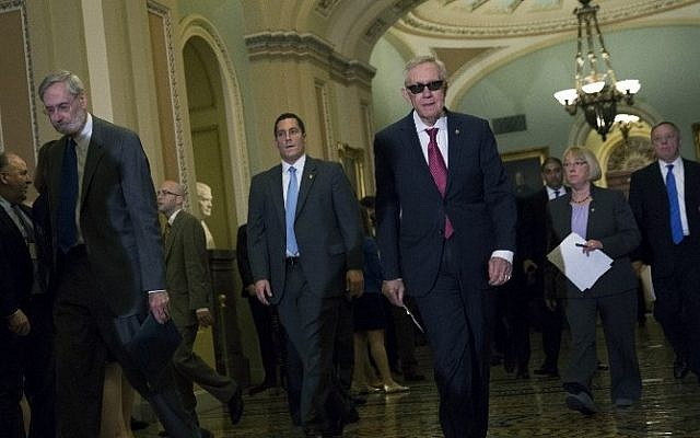 Senate Minority Leader Harry Reid (D-Nevada), center, arrives for a news conference after a policy meeting with Senate Democrats on Capitol Hill, April 28, 2015 in Washington, DC. (Drew Angerer/Getty Images/AFP)