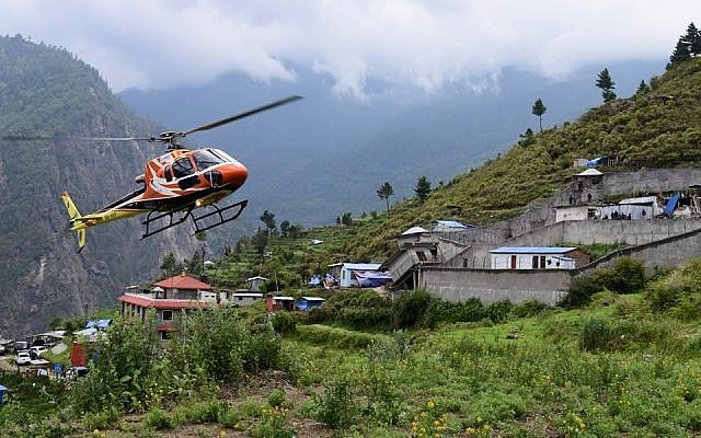 A helicopter searching for Israeli trekkers in the Langtang region of Nepal. ( photo credit: Chabad.org/Chabad of Nepal)