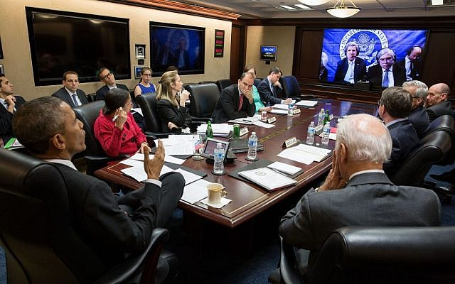 President Barack Obama and Vice President Joe Biden with members of the national security team participate in a secure video teleconference from the Situation Room of the White House with Secretary of State John Kerry, Secretary of Energy Ernest Moniz and the US negotiating team in Lausanne, Switzerland, to discuss the P5+1 negotiations with Iran, March 31, 2015. (White House/Pete Souza)