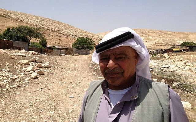 Deifallah, 65, the village elder of Jahallin-Arareh, stands next to his makeshift home east of Jerusalem, April 29, 2015 (photo credit: Elhanan Miller/Times of Israel)
