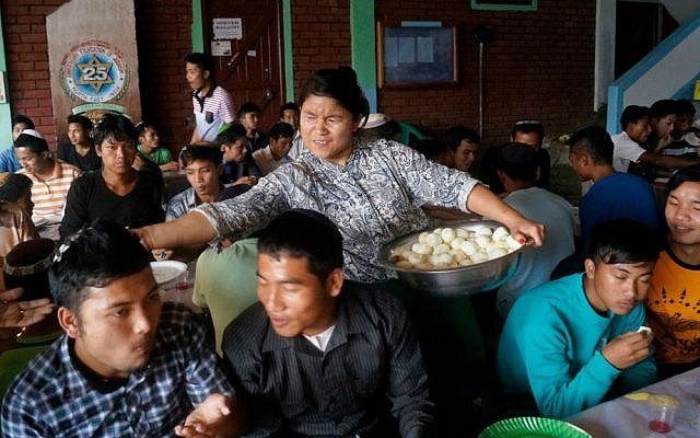 Hundreds of members of the Bnei Menashe community hold a model Passover seder in Churachandpur, in the Indian state of Manipur, Tuesday, March 31, 2015. (Jonathan Haukip/Shavei Israel)