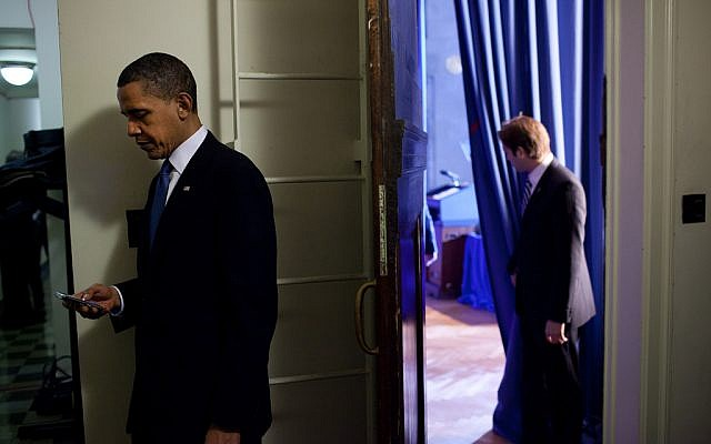 President Barack Obama checks his BlackBerry on March 23, 2010. (photo credit: White House/Pete Souza)