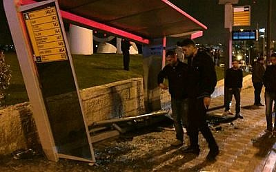 Police investigate the scene where a driver rammed his car into a bus stop in French Hill, Jerusalem, on April 15, 2015. (photo credit: Fire and Rescue Services)