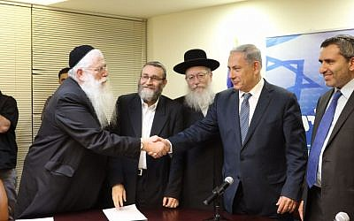 Likud head Prime Minister Benjamin Netanyahu shakes hands with UTJ's Meir Porush in the Knesset, April 29, 2015 after the two parties signed a coalition agreement. To Netanyahu's right is UTJ leader Yaakov Litzman. (photo credit: Courtesy Likud Party)