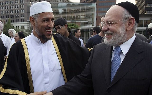 "Sheik Imam Mohammed Shchata, left, and Rabbi Albert Gabbi talk during a public assembly for religious tolerance on Septrmbrt 11, 2010, in Philadelphia. Leaders from Christian, Jewish and Muslim communities gathered in front of Philadelphia's Independence Hall on the anniversary of the Sept. 11 terrorism attacks to decry ""those who seek to divide us"" and reaffirm the America's commitment to religious tolerance. (photo credit: AP Photo/ Joseph Kaczmarek)"