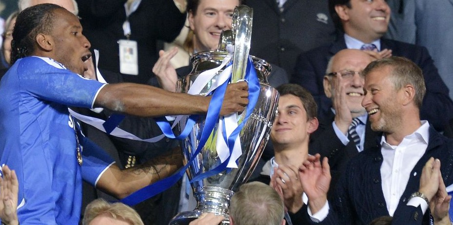 Chelseas Owner Roman Abramovich Right Applauds As Striker Didier Drogba Holds Up The Champions